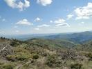 Auteur : Armel G, Commentaire : Panorama en haut du col. Une vue Sud Est avec tout au fond le Vercors.