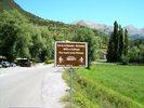 Montée : Cime de la Bonette depuis Jausiers, Commentaire : Voici le panneau indiquant le pied de l?ascension : nous sommes à 1220m d'altitude, il reste 23km avant la cime !